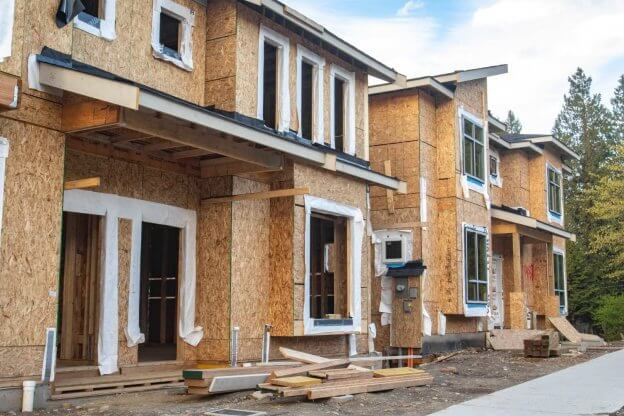 A row of townshomes being built as a real estate investment